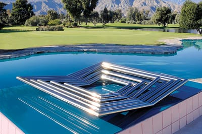 Square Waves, 1975, by Yaacov Agam. Polished stainless steel.