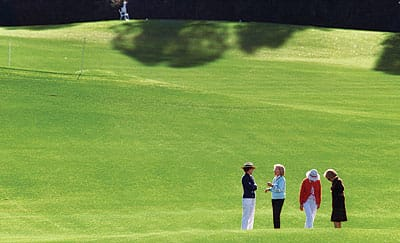 Shown here in a shot looking back from the fairway toward the tee on hole 3 are Nancy Reagan, Harriet Deutsch, Leonore Annenberg, and Jean French Smith.