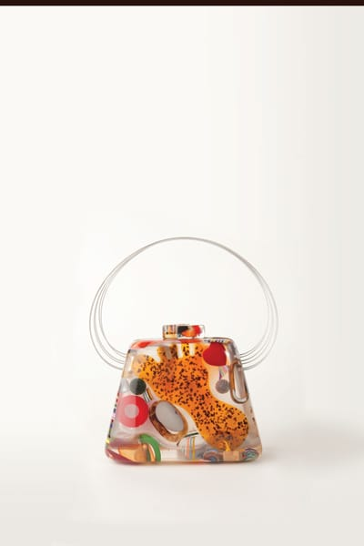 Colorful objects appear within the surface of this luminous resin handbag. By Borsal, $399, at Wil Stiles, Palm Springs.