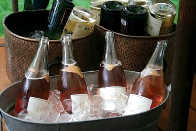 Bottles are chilled neck down to help them break cleanly; sabered bottles are chilled neck up to keep the wine in them.