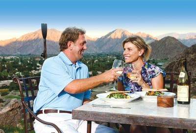 A golf-loving couple seeking a romantic experience enjoys dinner from the lofty 16th tee on the Mountain Course at La Quinta Resort & Club.