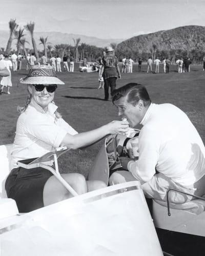 Sheila MacRae gives her husband Gordon a bite to eat.