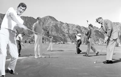 Playing at La Quinta Country Club are (from left): Dean Martin, Chuck Connors, Bob Hope, Dinah Shore, Arnold Palmer, Bing Crosby, and Frank Sinatra.