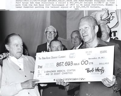 Bob Hope and former President Gerald Ford with a check from the 1977 Bob Hope Desert Classic