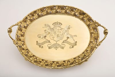 Tea trays, a soup tureen, a wine cooler, and baskets of various shapes and sizes are among the silver gilt collected by Walter and Leonore Annenberg. The inscriptions engraved on the bottom of baskets (shown above) designate them as having belonged to Prince Ernest Augustus, the fifth son of King George III. The artists include Benjamin Smith II, Paul Storr, Robert Garrard, William Pitts, and Joseph Preedy.