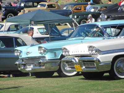 1958 Cadillac (left), and a '58 Mercury