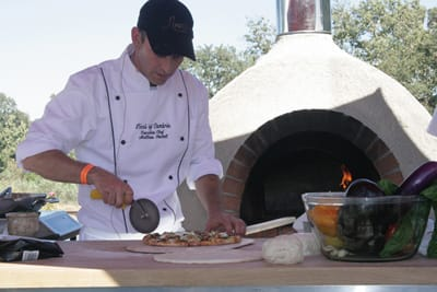 Matthew Beckett, executive chef at Linn's of Cambria, demonstrated how to make a ratatouille pesto pizza in an outdoor brick oven.