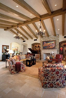 "Interior designer Donna Dunn worked with the Grahams to incorporate custom furnishings and décor accents, including a ""painting"" that conceals a high-definition television above the fireplace. Off the kitchen, a theater with luxurious seating offers a great environment for watching movies and sports."