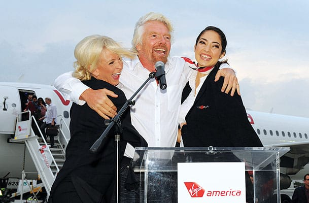 """Shortly before the inaugural Virgin America flight to Palm Springs landed, a storm blew in, leaving the desert uncharacteristically cold. After joking to the press and business leaders on the tarmac that he had been brought here """"under false pretenses,"""" since Mayor Steve Pougnet assured him it was a place where you could rely on the sun, Sir Richard Branson hugged the flight attendants for warmth and then changed his tune. """"Actually, I like the cold weather here,"""" he said. """"It's improved considerably."""""""