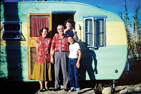 """""""This is classic desert style  on a budget. Mom and dad are dressed alike, the kid is sporting a souvenir Palm Springs T-shirt, and the trailer is beautifully finished in a luscious lemon-lime two-tone. Priceless!"""""""