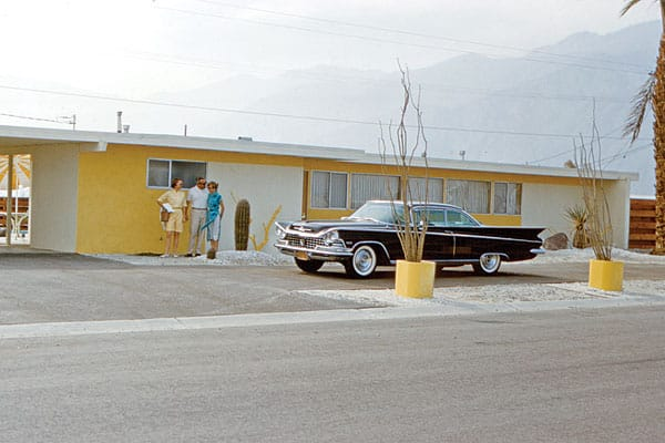 """""""A lemon meringue-flavored house complete with matching driftwood décor is totally upstaged by the fierce '59 Buick Electra posing in the pass-through driveway."""""""