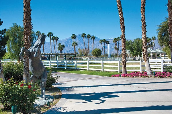 In addition to the 5,000-square-foot, two-bedroom main house, the estate that Merv Griffin built in La Quinta includes four freestanding guest casitas, a 2.5-acre lake with a dock, paddocks, grazing pastures, racetrack, air-conditioned stables, and training area.