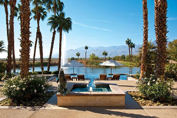 The water feature adjacent to the main house flows into an infinity pool, which spills into the lake. The location also offers views of the Santa Rosa Mountains.