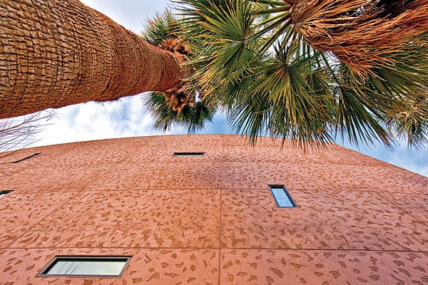 """A very wide-angle lens provides great depth of field. """"I love the texture that they put on the building,"""" he says. """"I got to thinking about it being roughly related to the texture of the palm trunks. And I wanted to show the sky with these little windows. ... It wasn't so much about the convention center anymore; it was a study of man and nature, texture, and color."""""""