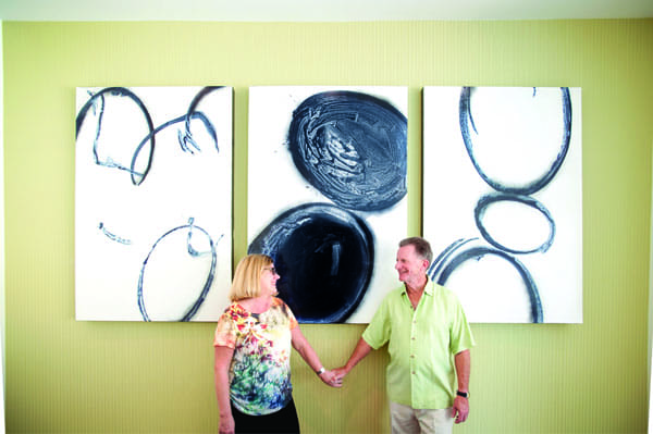 "Elizabeth Smalley and Garth Gilpin commissioned Palm Springs artist Shawn Savage to create three black-and-white paintings for a ""Liberace green"" wall. ""We wanted something graphic and modern, with a lot of punch,"" says Christopher Kennedy."