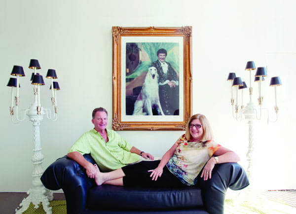 "Garth Gilpin and Elizabeth Smalley relax in the foyer of their Palm Springs home, where Liberace lived from 1968 to 1972. They purchased the property in 2010, before producer and Oscar-winning director Steven Soderbergh began filming his Liberace biopic Behind the Candelabra (scheduled for release in 2013). ""The timing has been really interesting,"" Smalley says. ""It's like there's this new fever for Liberace, and we caught it."""