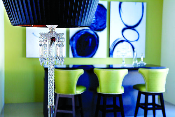 A Baccarat lamp with chandelier-style prisms accents the living area where a bar built for Liberace previously featured a mirrored and gray marble surface.