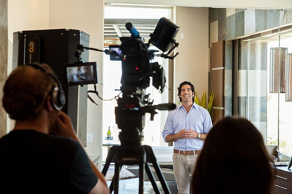 HGTV <em>Million Dollar Rooms</em> host Carter Oosterhouse talks to the camera, introducing the master suite of the Mirada residence in Rancho Mirage.