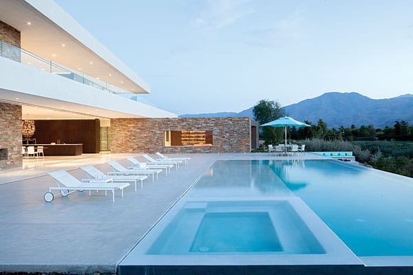 The master suite looks onto the pool below and the mountains to the west and opens to a sheltered deck running the length of the house from north to south.