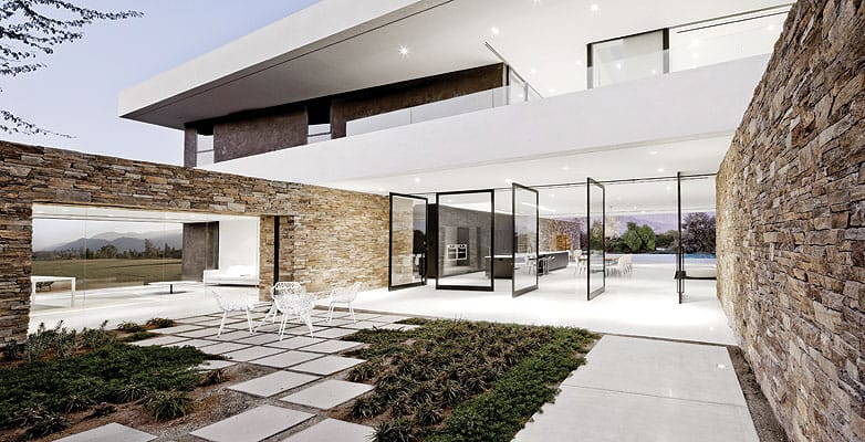The house opens in every direction, including the courtyard off the office and kitchen, to passively cool interior spaces.