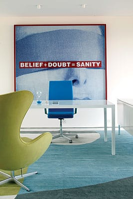A painting by Barbara Kruger defines the office space.