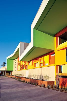The Coachella Valley Rescue Mission in Indio, designed by Phillip K. Smith III and completed in 2012, features deep overhangs; bold color composition; horizontal emphasis; and complex, deep-shaded window groupings that recall the innovative architecture of Albert Frey and his mentor, French master le Corbusier. The courtyard plan behind the main façade uses durable horizontal metal shading louvers akin to Frey's work. The roofline and some of the window shading devices that owe allegiance to Rudy Baumfeld's 1959 City National Bank (now Bank of America) building in downtown Palm Springs, also inspired by Le Corbusier.