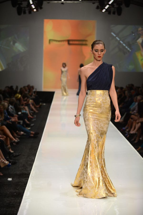 Designer Michael Costello shows off current designs during the Fashion Week El Paseo Drama and Designes of Project Runway
