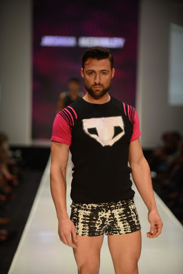 Designer Joshua McKinley shows off current designs during the Fashion Week El Paseo Drama and Designes of Project Runway