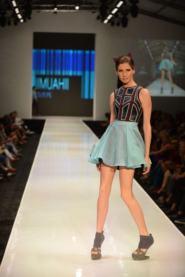 Designer Elena Slivnyak shows off current designs during the Fashion Week El Paseo Drama and Designes of Project Runway