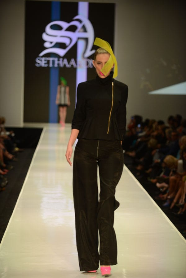 Designer Seth Aaron shows off current designs during the Fashion Week El Paseo Drama and Designes of Project Runway