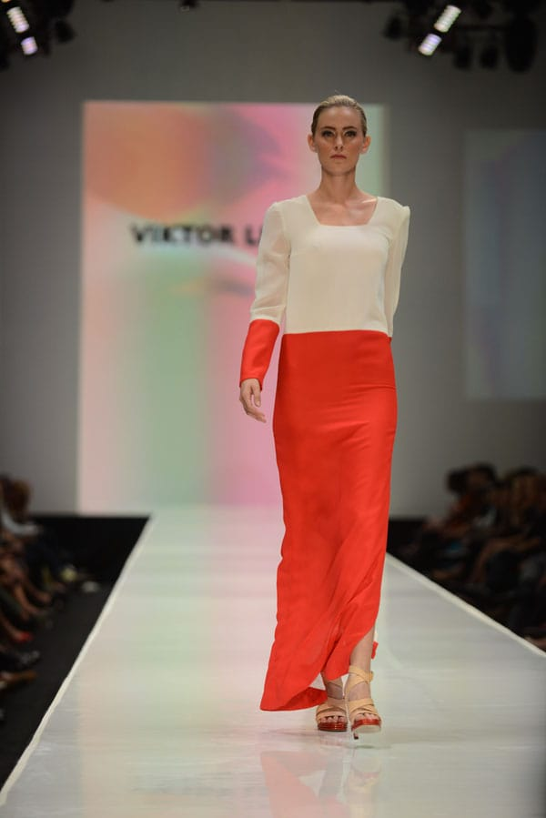 Designer Viktor Luna shows off current designs during the Fashion Week El Paseo Drama and Designes of Project Runway