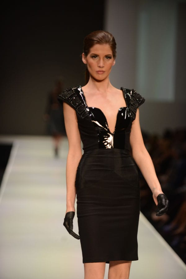 Designer April Johnston shows off current designs during the Fashion Week El Paseo Drama and Designes of Project Runway