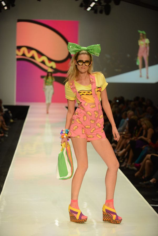 Designer Mondo Guerra shows off current designs during the Fashion Week El Paseo Drama and Designes of Project Runway