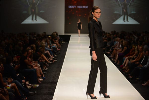 Designer Bert Keeter shows off current designs during the Fashion Week El Paseo Drama and Designes of Project Runway