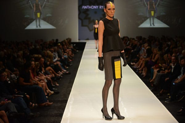 Designer Anthony Ryan  shows off current designs during the Fashion Week El Paseo Drama and Designes of Project Runway
