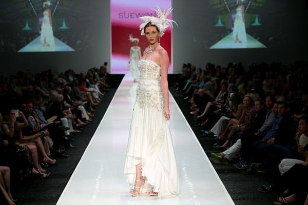 Tiered layers, exquisite embroidery, and meticulous detailing dominated the dresses that veteran L.A. designer Sue Wong sent down the runway Thursday night at Fashion Week El Paseo.