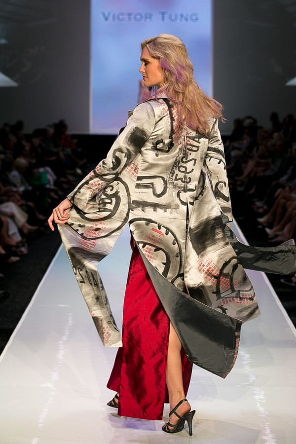 "A San Francisco artist and couture designer, presents his women's collection of one-of-a-kind ""wearable art"" that he creates from his own fabrics."
