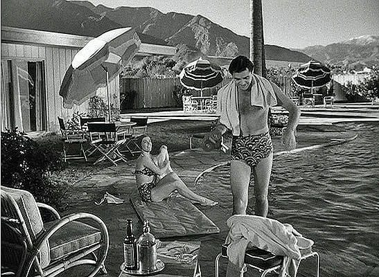 Actor Steve Cochran enjoys the pool at the Frank Sinatra's Twin Palms Estate in Palm Springs.