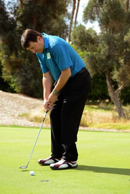 Rancho Mirage City Manager Randy Bynder concentrates on his putt.