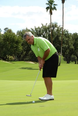 Brian Hansberry, CEO of the Agua Caliente Spa Resort Casino and member of both the Rancho Mirage Tourism Advisory Committee and Rancho Mirage Chamber of Commerce Board, gauges the distance between ball and hole before sinking the putt.
