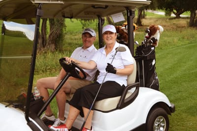 Francoise Rhodes, local radio celebrity from Golf is a Four Letter Word and Traveling with Francoise, heads to the next hole with golfing buddy  Jim Moran, General Manager of the Westin Mission Hills Resort & Spa.  Jim took home top honors in the Net Division with a score of 32.