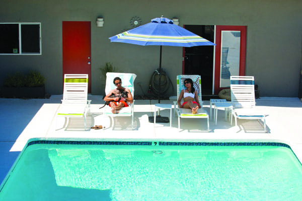 Max, a pit bull, takes in some sunshine at DogSpa Resort and Wellness Center in Desert Hot Springs with Edmund Shadman and Chetna Sidhu.