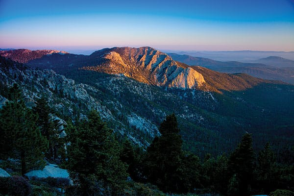From Pacific Crest Trail, Tom Brewster photographs the sunset over Tahquitz Rock, also called Lily Rock.