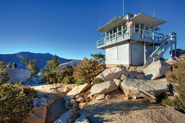 In three-day shifts, volunteer firefighters keep watch for forest fires at Tahquitz Peak Lookout.