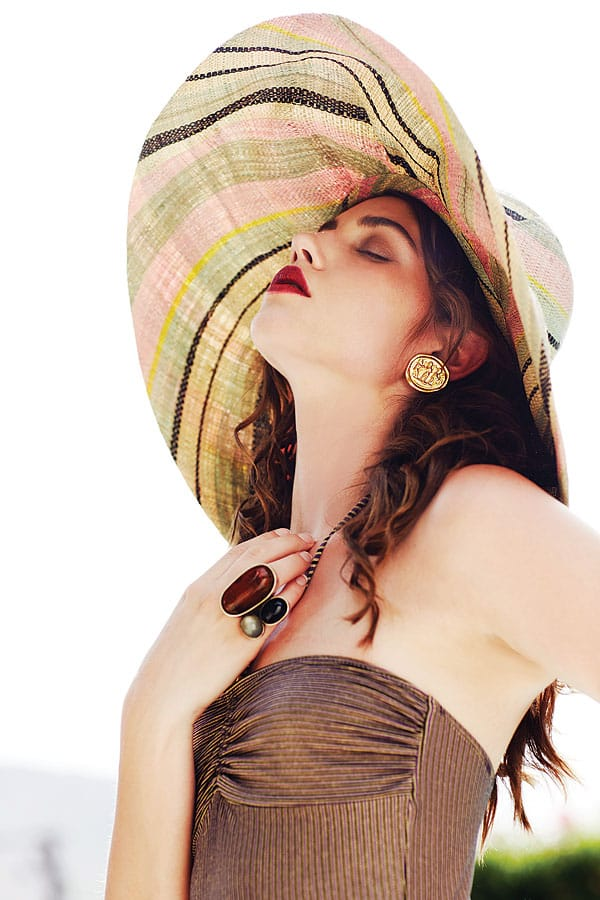 Wide-brimmed sunhat ($58), at Anthropologie, Palm Desert. Gold-plated coin earrings ($125), amber, onyx, and moonstone ring ($695) by Heidi Abrahamson, both at Flow Modern Design. Pinstriped Ms. Penelope swimsuit ($198) by Jules Moore, shop.julesmoore.com.