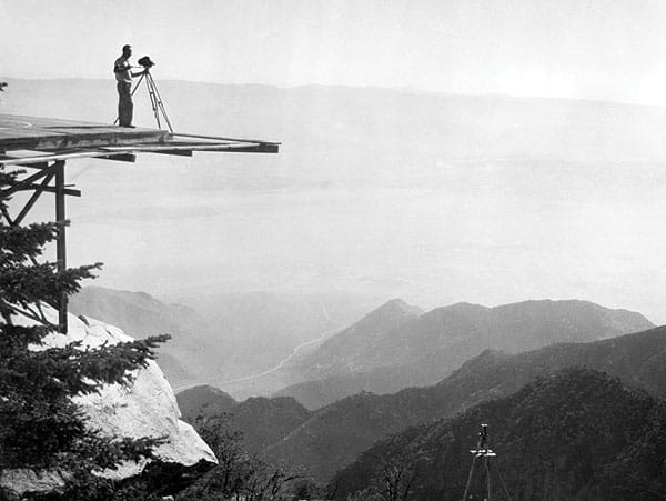 An enginner surveying on one of the tower platforms, circa 1962.