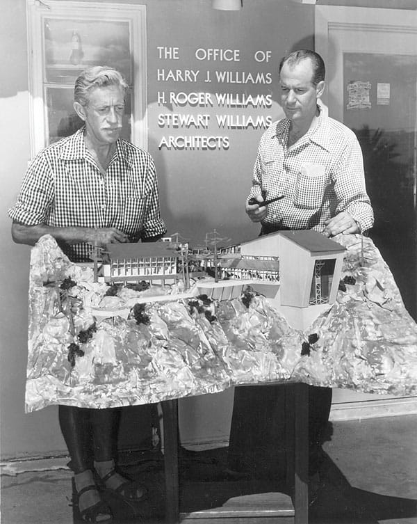 Artist O.E.L. Graves and E. Stewart Williams look at a model for the tramway's Mountain Station.
