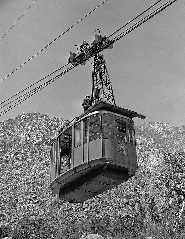 Workmen service the Aerial Tram as it ascends on July 21, 1965