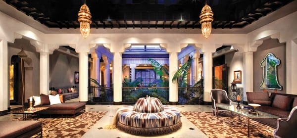 Most rooms at Casbah Cove open to the central arcade that surrounds an atrium with palms and lush landscaping.
