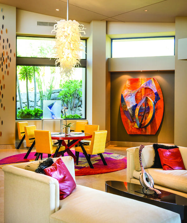 In the dining room, a glass sculpture by Petr Hora is situated in front of a window, flanked by a wall piece by Sam Gilliam. Valerie McNamara designed most of the interior, as well as all of the rugs.